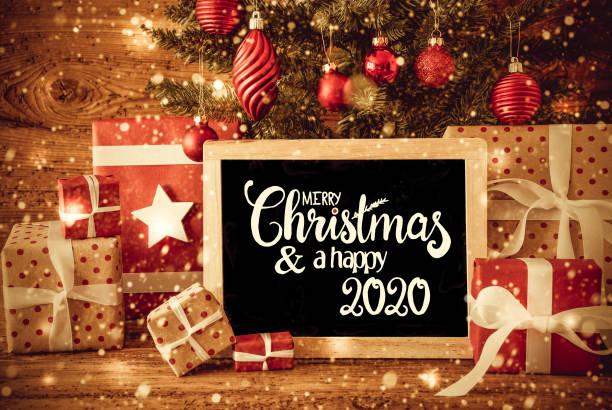 Weihnachtsbaum, Geschenk, Text Frohe Weihnachten und ein glückliches 2020, Schneeflocken – Foto