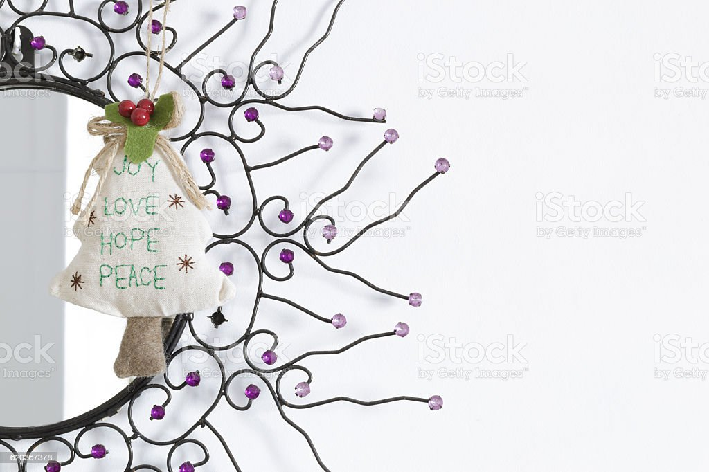 Christmas tree hanging in a room mirror foto de stock royalty-free