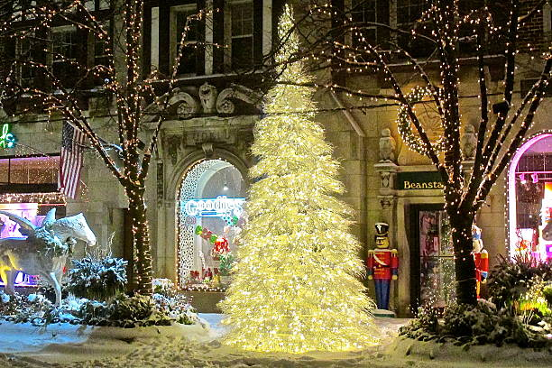 Christmas tree, holiday lights, decorations and snow downtown stock photo