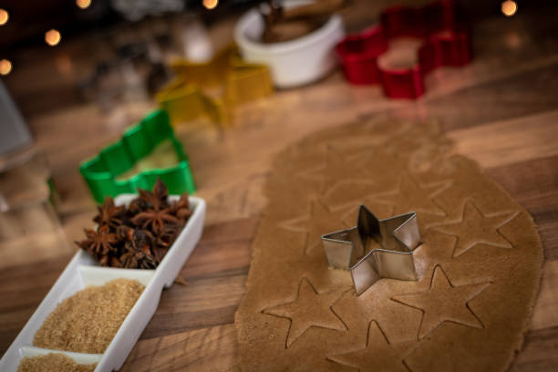 christmas tree, holly, star shaped cutting out cookies - christmas stock photos and pictures