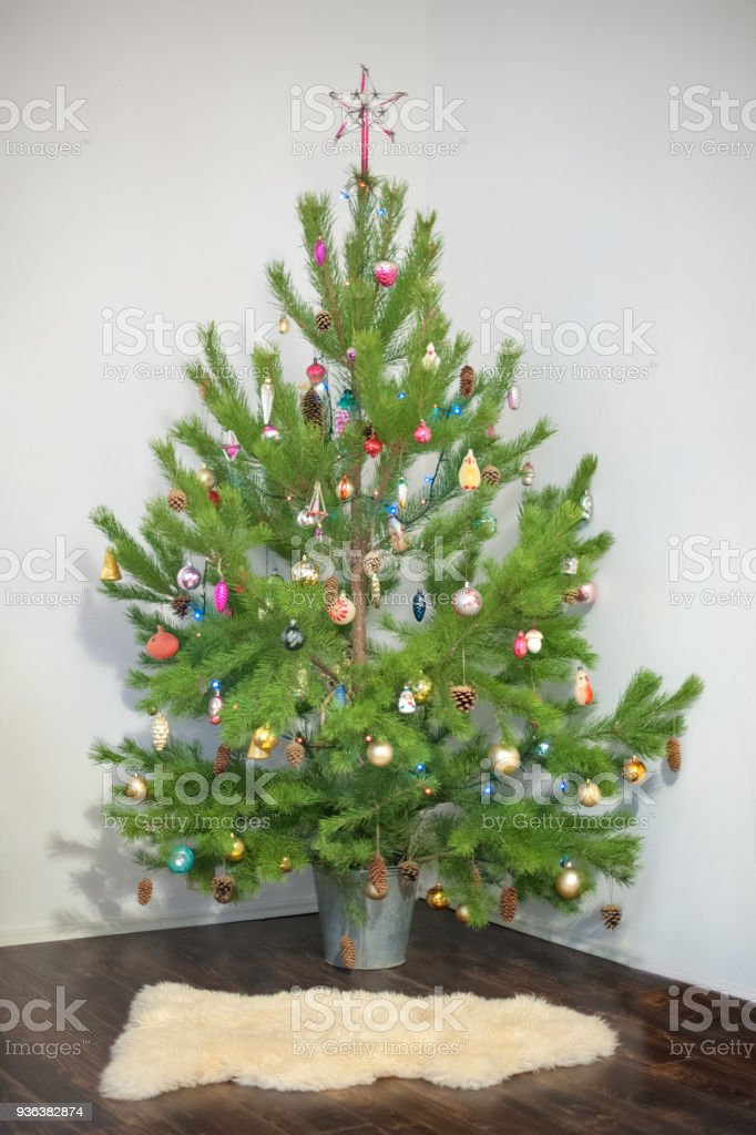 Christmas tree in garlands stock photo
