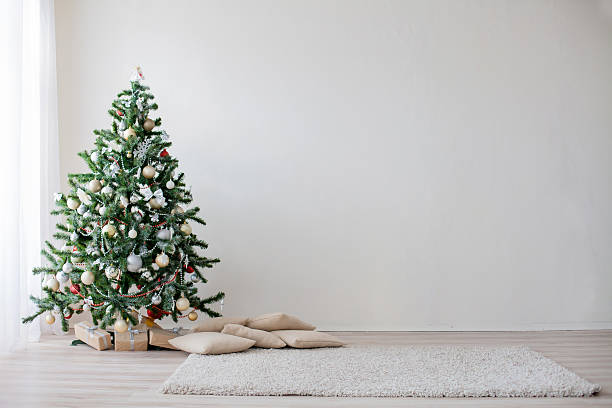 Christmas tree in the white room new year Christmas tree in the white room new year christmas interior stock pictures, royalty-free photos & images