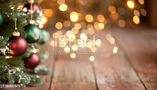Christmas Tree with Red and Green Baubles and Intentionally Defocused with Gold Lights Background