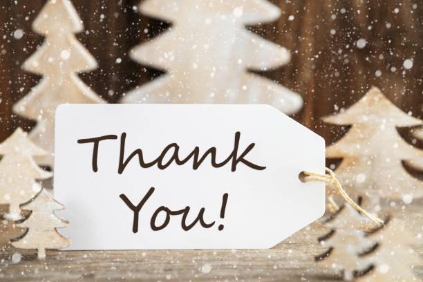 Weihnachtsbaum, Label mit englischem Text Danke, Schneeflocken – Foto