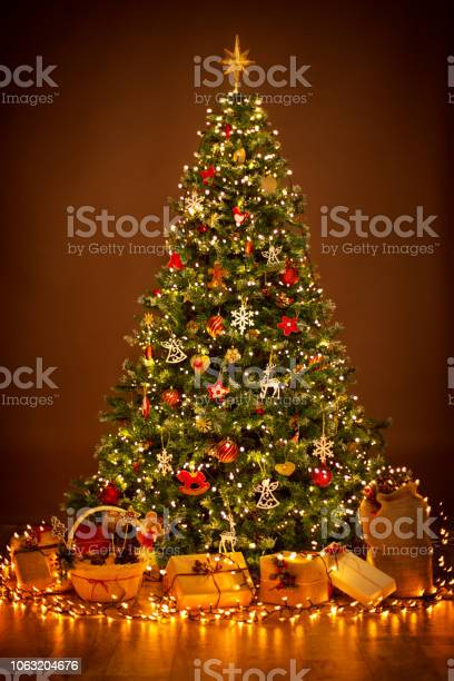 Christmas tree lighting in night xmas decorations present gifts picture id1063204676?b=1&k=6&m=1063204676&s=612x612&h=3buicybonkys8iwcr1vphmvy0hlfzb4rs0zskps92cm=