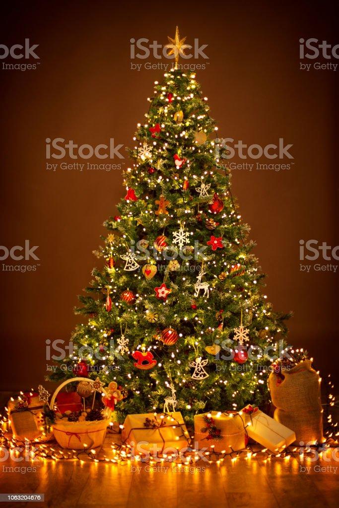 Christmas Tree lighting in night, Xmas Decorations, Present Gifts stock photo