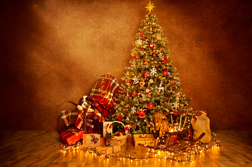 istock Christmas Tree Lights in Decorated Xmas Room Interior, Presents Gifts 1063204720