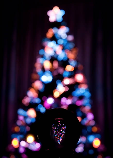 Christmas tree lights reflected in glass ball stock photo