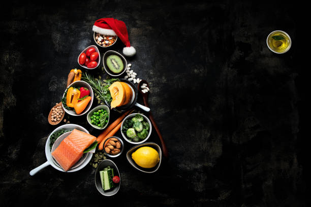 christmas tree made from healthy food - christmas background стоковые фото и изображения