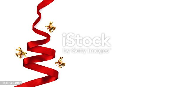 istock Christmas tree made from ribbon on white background 1067330382