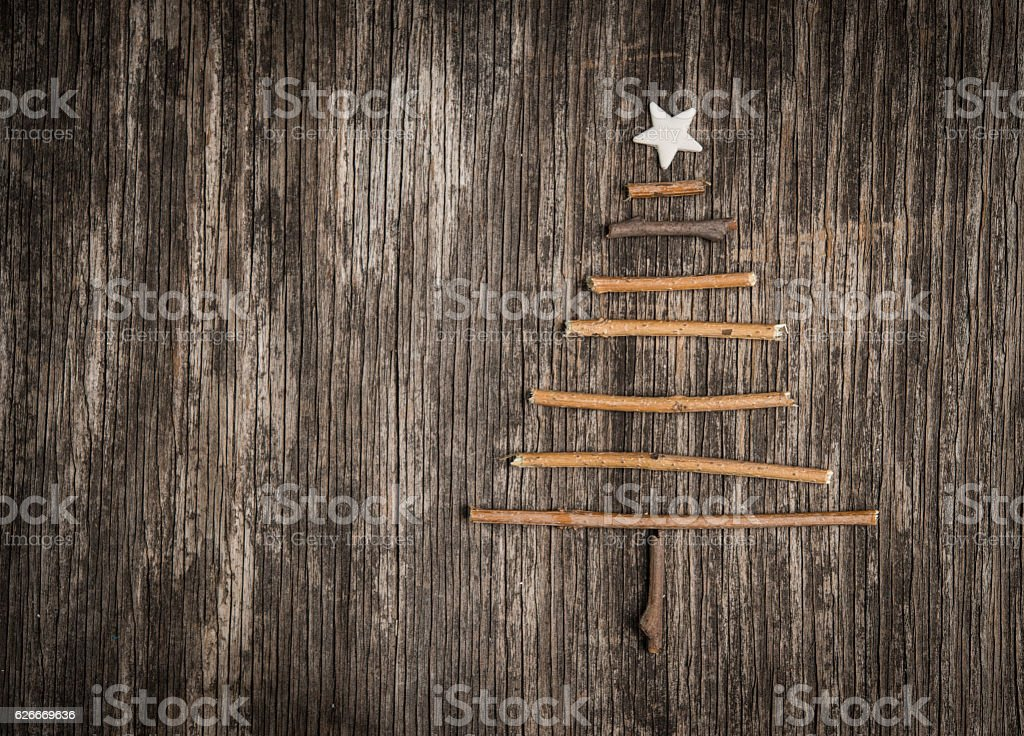 Christmas tree made of branches and golden pearls stock photo