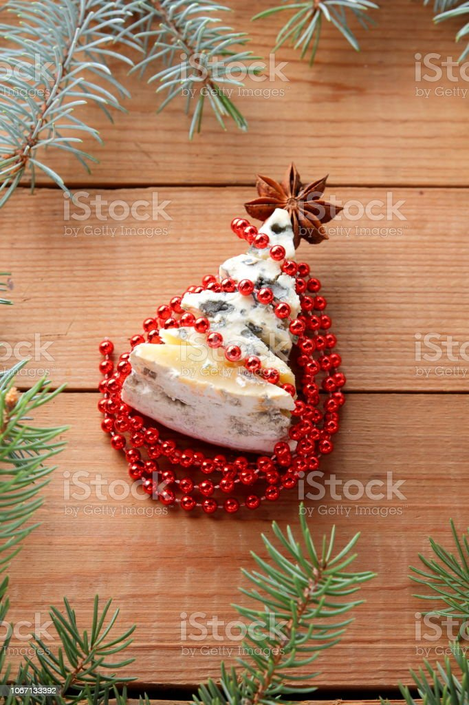 Christmas Tree Made Of Cheese With Red Decorations On Wooden