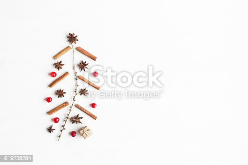 istock Christmas tree made of cinnamon sticks, anise star, larch branches 619238284