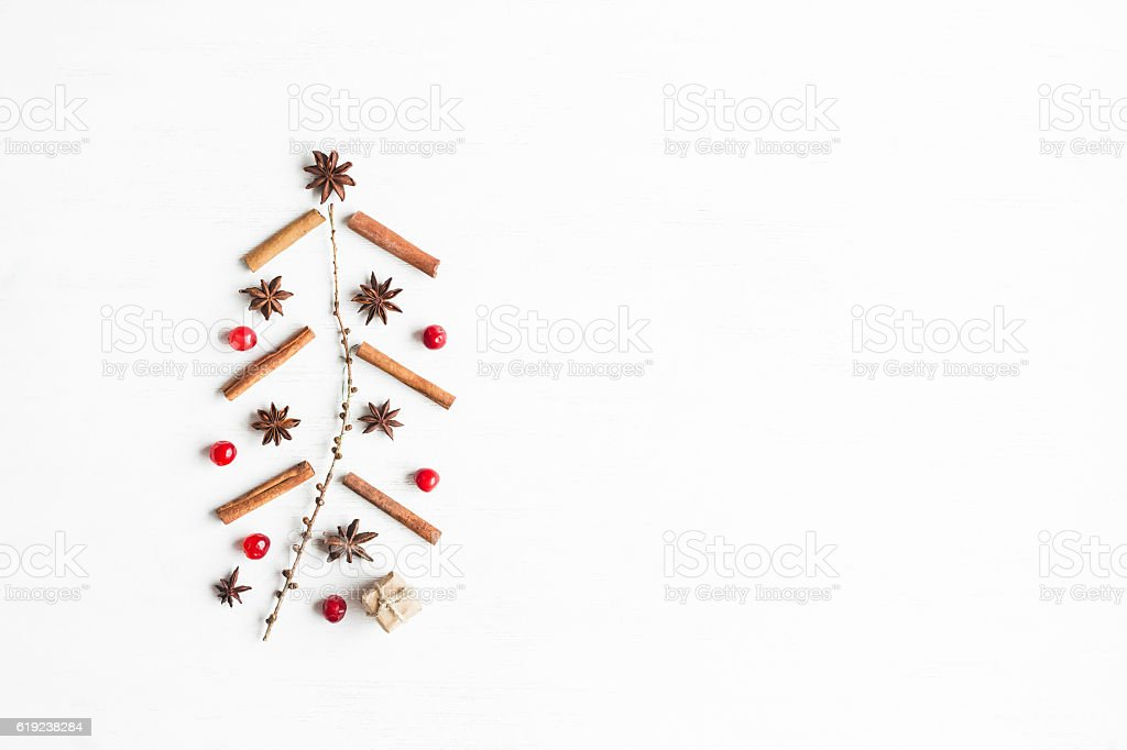 Christmas tree made of cinnamon sticks, anise star, larch branches stock photo