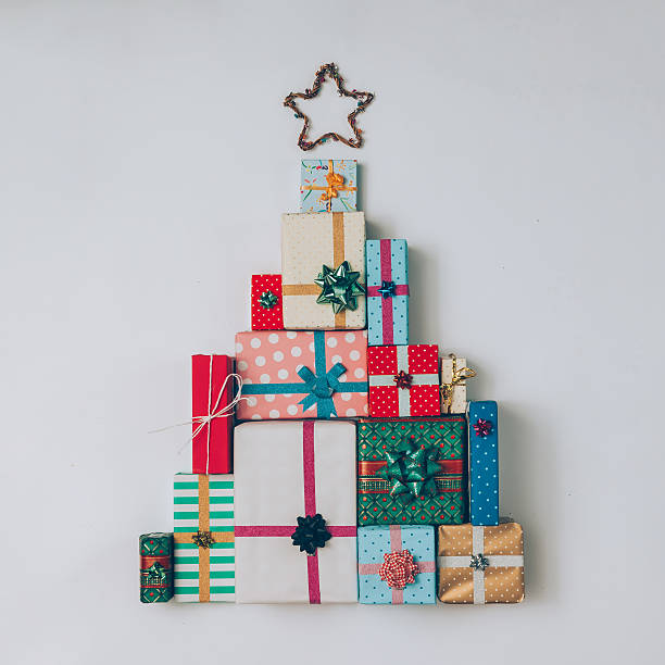 Christmas tree made of colorful presents and gifts. 스톡 사진