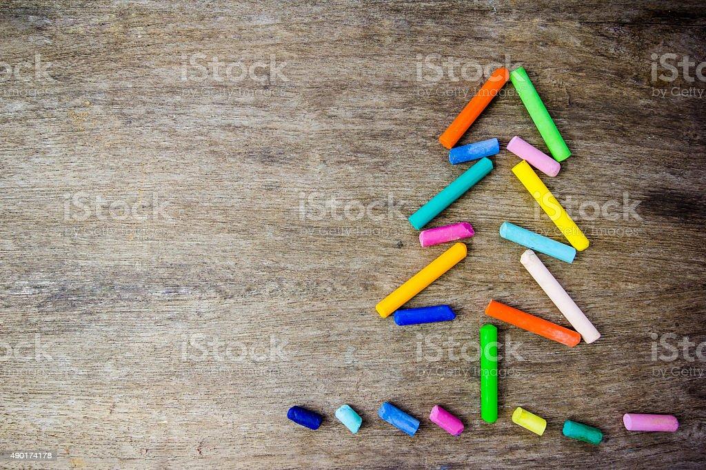 Christmas tree made of crayons stock photo