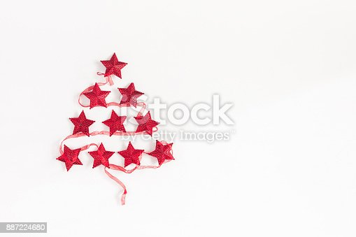1064023690 istock photo Christmas tree made of red garland. Flat lay, top view 887224680