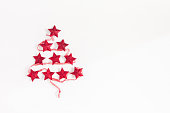 istock Christmas tree made of red garland. Flat lay, top view 887224680