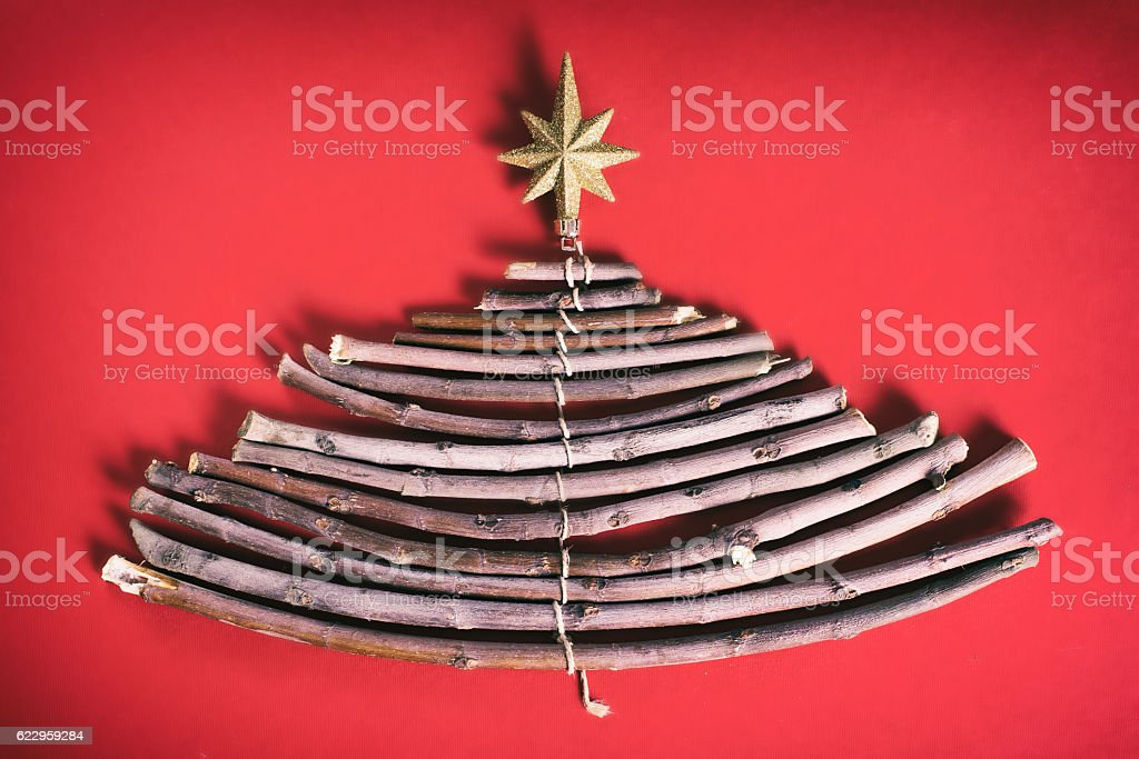 Christmas tree made of wooden branches stock photo