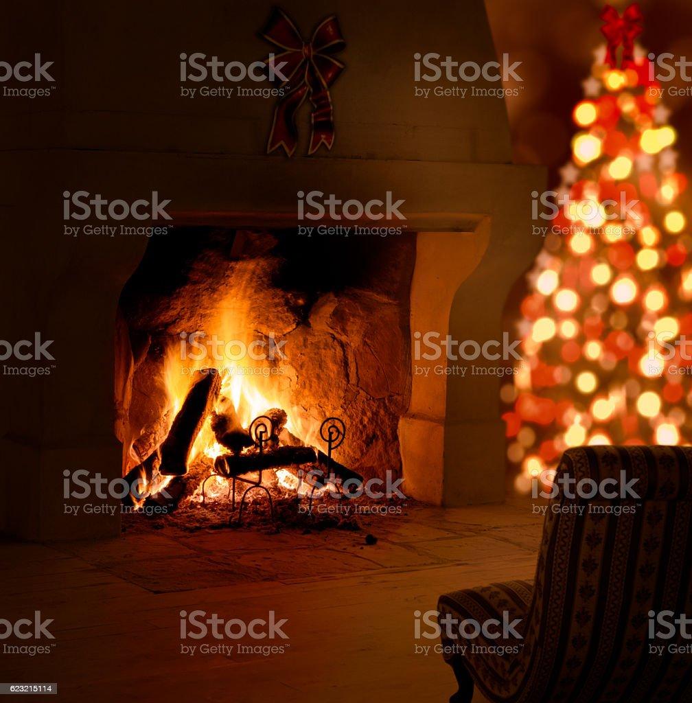 Christmas tree near fireplace. stock photo