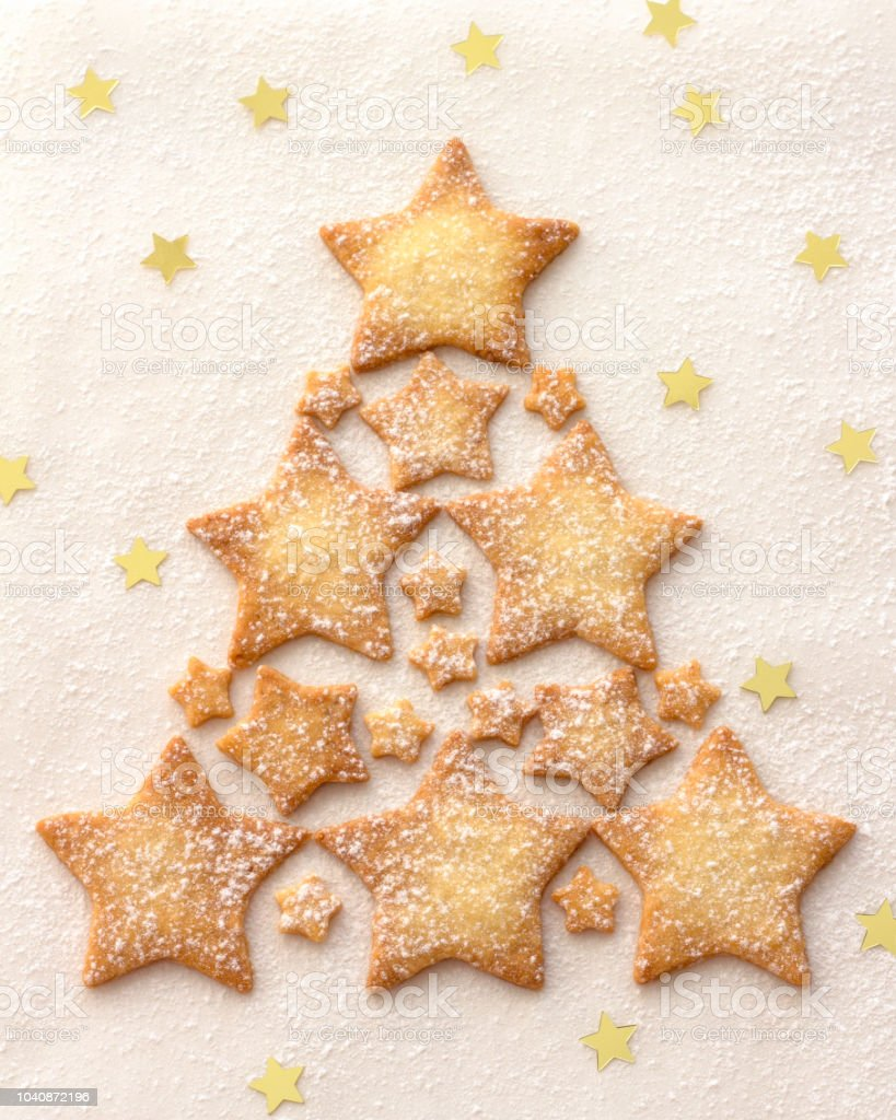 Christmas Tree Of A Star Cookie Sprinkled With Powdered Sugar On A