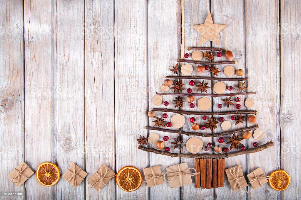 Christmas tree on a rustic wood background. stock photo