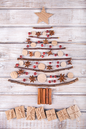 istock Christmas tree on a rustic wood background. 869906166