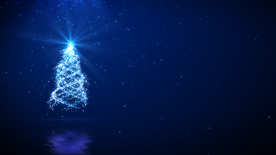 Christmas tree on blue background with space for your text