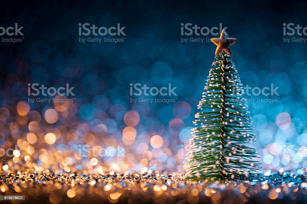 Christmas tree on defocused lights. Decorations Bokeh Blue Gold - Photo