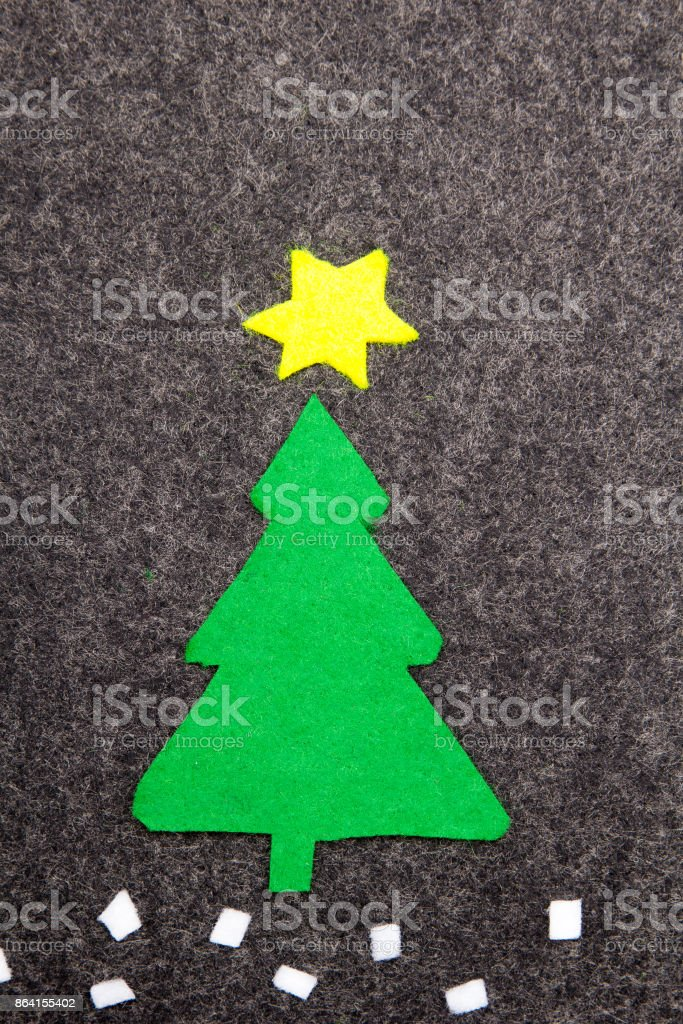 Christmas tree on grey background.  Felt Christmas ornaments with copy space royalty-free stock photo