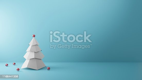 istock Christmas tree on paper color background with copy space Minimal style 3D render 1166441358