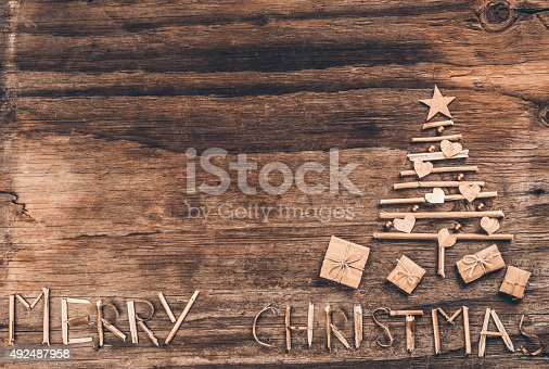 527392693 istock photo Christmas tree on rustic wood 492487958