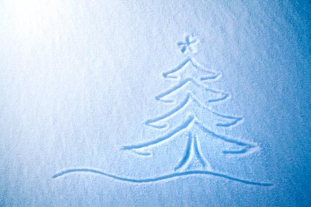 christmas tree on schnee - es schneit text stock-fotos und bilder