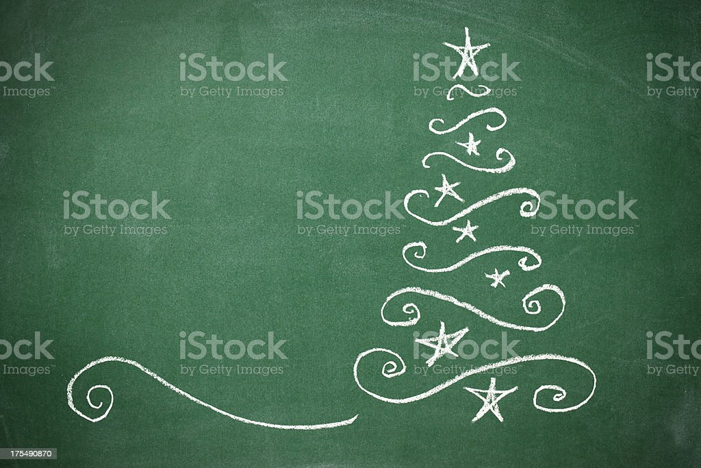 Christmas tree on the blackboard royalty-free stock photo