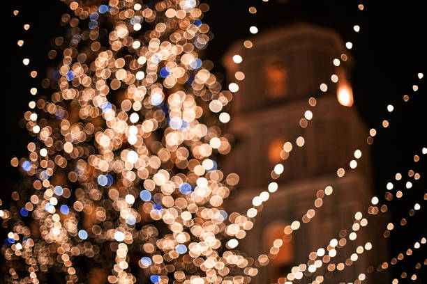 christmas tree on the main city square at night - soft focus stock photos and pictures