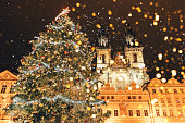 Christmas tree on the main square in Prague, bokeh from lanterns