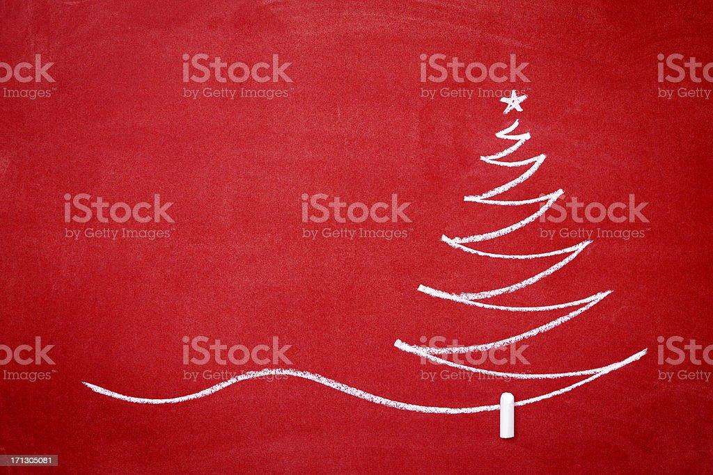 Christmas tree on the redboard stock photo