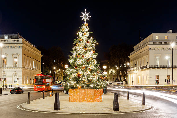 Christmas tree on Waterloo place in 2016, London Christmas tree on Waterloo place in 2016, London, England mayfair stock pictures, royalty-free photos & images