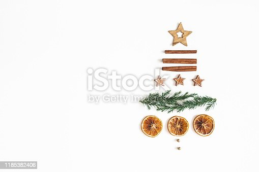1076055746 istock photo Christmas tree on white background. Christmas, winter, new year concept. Flat lay, top view, copy space 1185382406