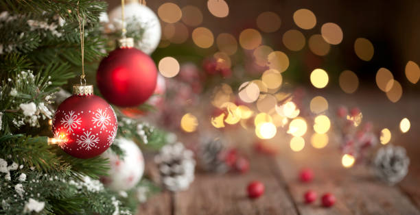 Christmas Tree, Ornaments and Defocused Lights Background Christmas tree with red and white baubles and lights against an old wood background christmas ornament stock pictures, royalty-free photos & images