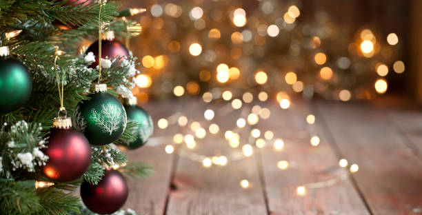Christmas Tree, Red and Green Ornaments against a Defocused Lights Background stock photo
