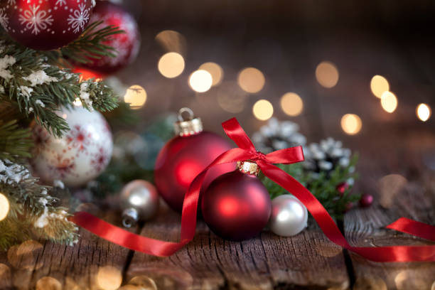 Christmas Tree, Red and White Ornaments against a Defocused Lights Background stock photo