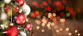 istock Christmas Tree, Red and White Ornaments against a Defocused Lights Background 1281862582