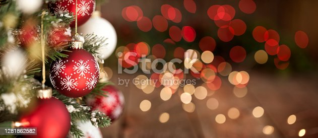 Christmas Tree, Red and White Ornaments against a  Defocused Lights Background