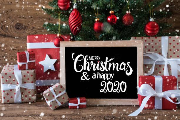 Weihnachtsbaum, Schneeflocke, Geschenk, Text Frohe Weihnachten und ein glückliches 2020 – Foto