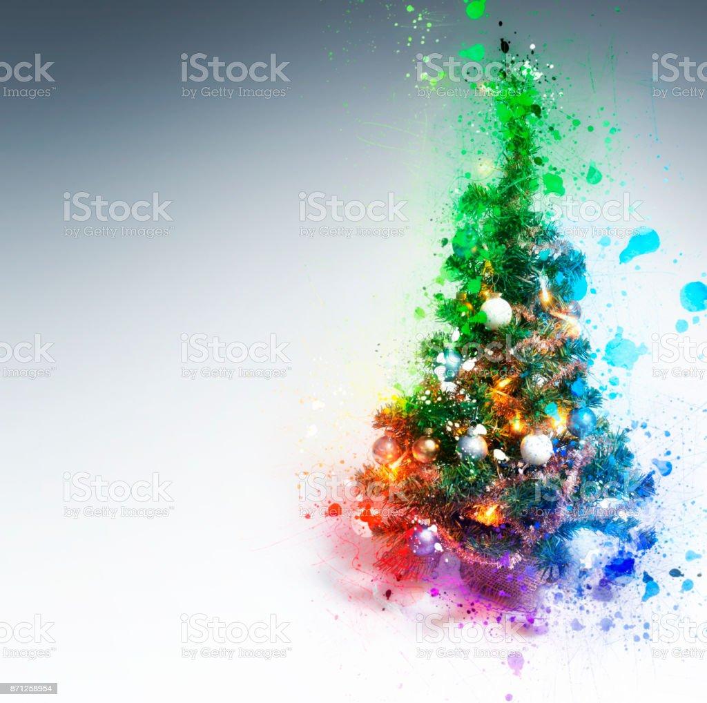 Christmas Tree splashing on gradient background stock photo