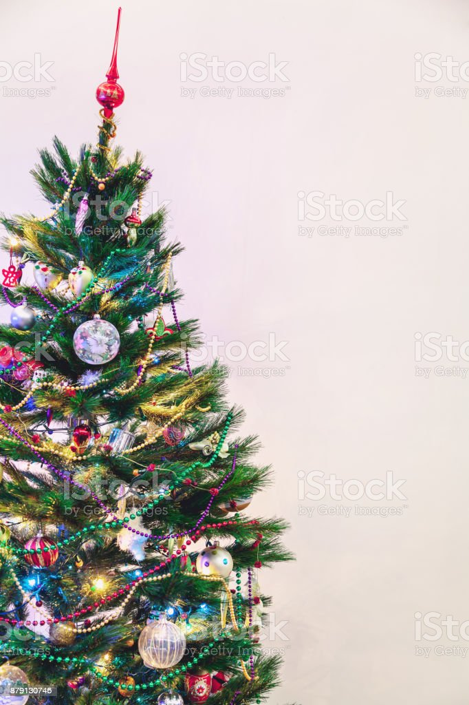 Christmas Tree Stands On White Wall Background stock photo 879130746 ...