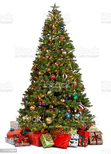 Photo of Christmas tree surrounded by presents on white background
