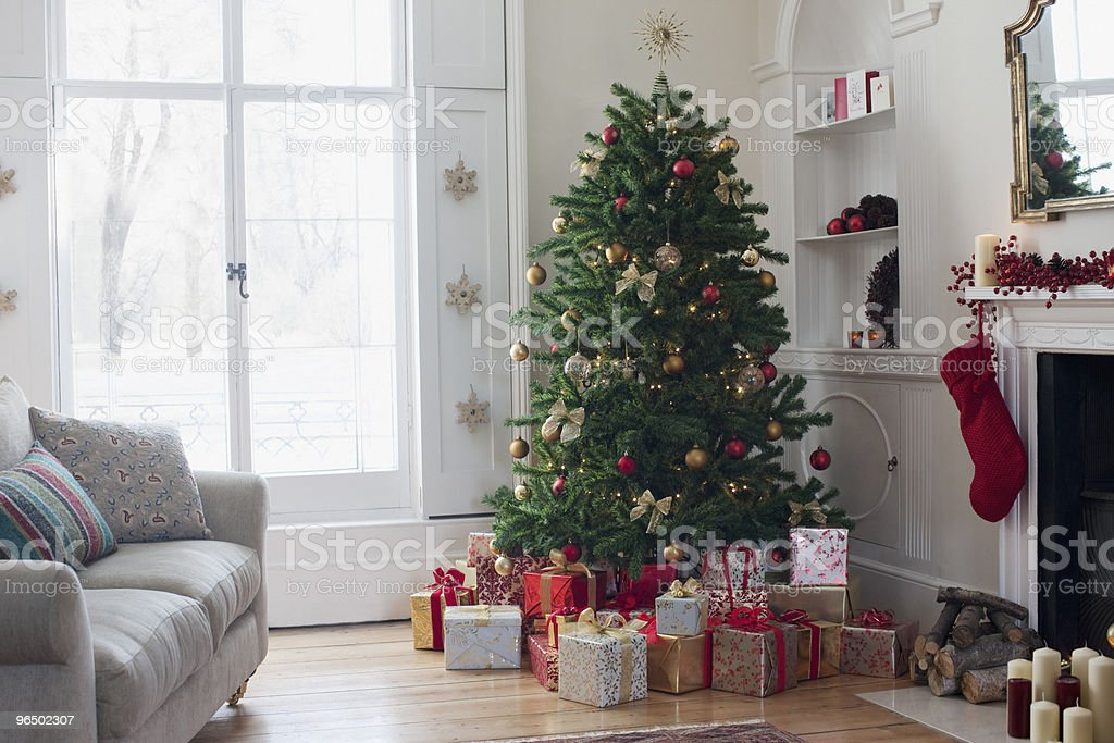 Christmas tree surrounded with gifts stock photo