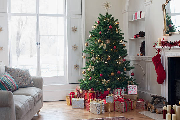 Christmas tree surrounded with gifts  christmas trees stock pictures, royalty-free photos & images